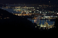 Night view of North Vancouver from Burnaby Mountain Conservation Area in Burnaby, British Columbia, Canada. This view shows the industry of North Vancouver along Burrard Inlet from the Second Narros Bridge through to the Lions Gate (First Narrows) as well as Stanley Park and English Bay.