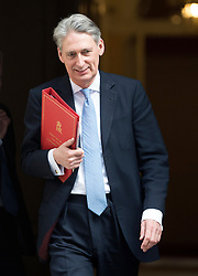 © Licensed to London News Pictures. 18/03/2015. Westminster, UK. Philip Hammond, Foreign Secretary, leaves Downing Street on the day of the spring budget 2015. Photo credit : Stephen Simpson/LNP