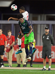NEW YORK, NEW YORK, USA - Wednesday, July 24, 2019: Liverpool's Rhian Brewster (top) wins a header from Sporting CP's Thierry Rendall Correia during a friendly match between Liverpool FC and Sporting Clube de Portugal at the Yankee Stadium on day nine of the club's pre-season tour of America. (Pic by David Rawcliffe/Propaganda)