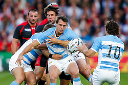 Argentina Winger Juan Imhoff offloads to Fly-Half Nicolas Sanchez - Mandatory byline: Rogan Thomson/JMP - 07966 386802 - 25/09/2015 - RUGBY UNION - Kingsholm Stadium - Gloucester, England - Argentina v Georgia - Rugby World Cup 2015 Pool C.