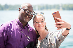 """1 July 2018, Geneva, Switzerland: ÁRNADÓTTIR, Ms Thuridur Björg Wiium, The Evangelical Lutheran Church of Iceland (ICELAND) takes photo with LWF president Archbishop Musa Panti Filibus. Following Sunday service at the Evangelical Lutheran Church in Geneva, LWF Council members journeyed from Geneva to Nyon by boat across Lake Geneva. The 2018 LWF Council meeting takes place in Geneva from 27 June - 2 July. The theme of the Council  is """"Freely you have received, freely give"""" (Matthew 10:8, NIV). The LWF Council meets yearly and is the highest authority of the LWF between assemblies. It consists of the President, the Chairperson of the Finance Committee, and 48 members from LWF member churches in seven regions."""