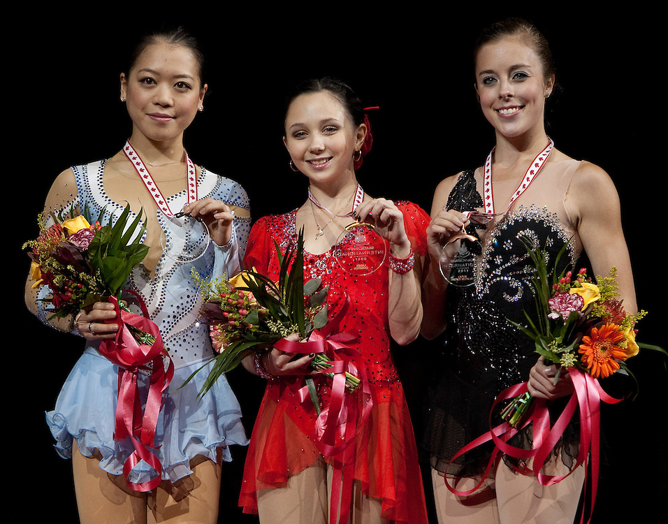 -20111029- Mississauga, Ontario,Canada-  Gold medalist Elizaveta Tuktamisheva of Russia, centre, Silver medalist Akiko Suzuki of Japan, left, and Ashley Wagner of the United States pose with their medals at Skate Canada International, in Mississauga, Ontario, October 29, 2011.<br /> AFP PHOTO/Geoff Robins