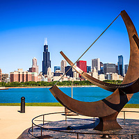 Picture of Chicago Adler Planetarium sundial named Man Enters the Cosmos with the Chicago downtown skyline in the background. Photo is high resolution.