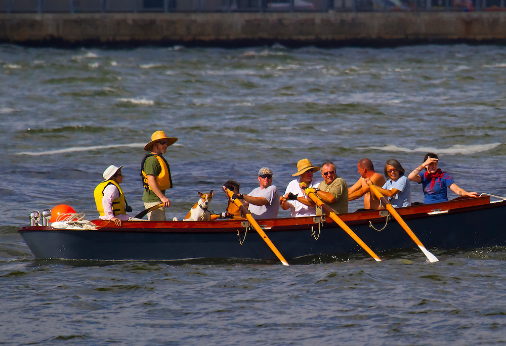 Rowers out for some fun in the Hudson River headed towards the Brooklyn Bridge and beyond.