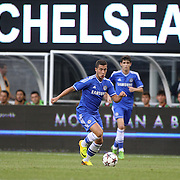 Eden Hazard, Chelsea, watched by team mate Oscar, in action during the Chelsea V AC Milan Guinness International Champions Cup tie at MetLife Stadium, East Rutherford, New Jersey, USA.  4th August 2013. Photo Tim Clayton