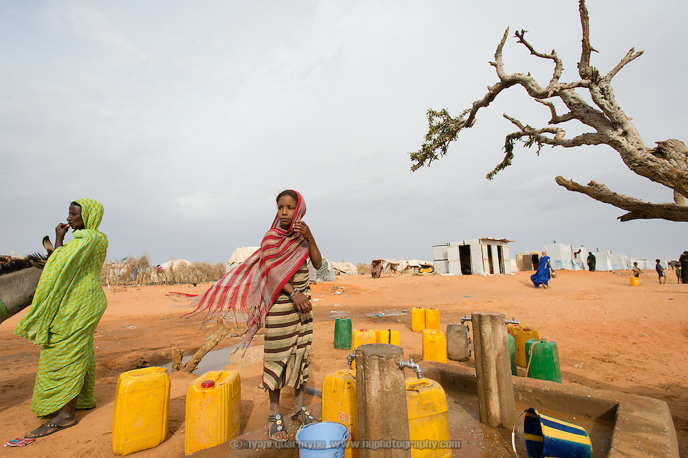 A girl collecting water at the Mbera camp for Malian refugees in Mauritania on 2 March 2013.