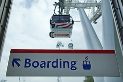 © Licensed to London News Pictures. 28/06/2012. LONDON, UK. An Emirates Air-Line cabin is seen leaving the Greenwich Peninsula Terminal at the launch of London's first cable car system today (28/06/12). The new cable car system, running across the River Thames between the Greenwich Peninsula and the Royal Docks in East London, was today opened to the public, despite fears that it would not be ready in time for the London 2012 Olympics. Photo credit: Matt Cetti-Roberts/LNP