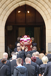 © Licensed to London News Pictures . 30/08/2012 . Manchester, UK . The coffin carrying the body of Winnie Johnson entering St Chrysostom's Church, Victoria Park in Manchester on August 30, 2012 following the funeral. Winnie Johnson devoted her life to finding the body of her 12 year old son Keith Bennett who was murdered by Moors Murderer Ian Brady and Myra Hindley. Photo credit : Joel Goodman/LNP