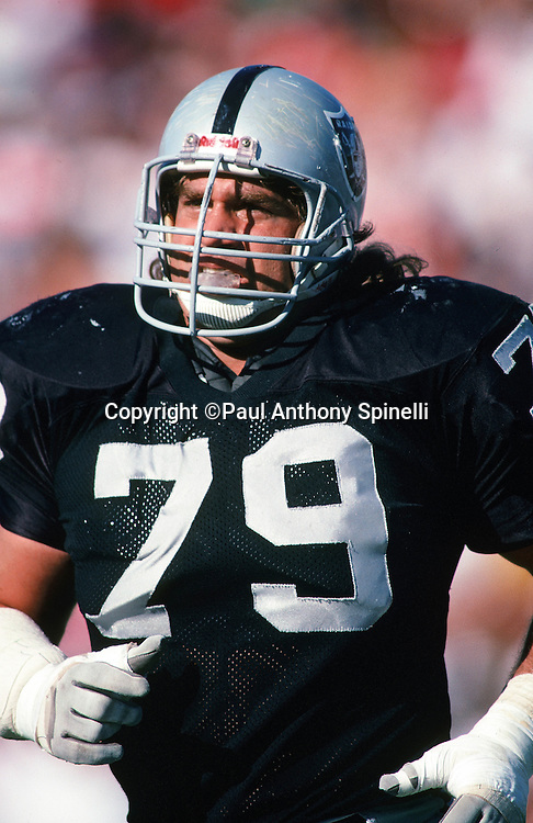 Los Angeles Raiders nose tackle Bob Golic (79) jogs off the field during the NFL football game against the New England Patriots on Nov. 26, 1989 in Los Angeles. The Raiders won the game 24-21. (©Paul Anthony Spinelli)