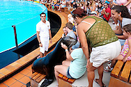Entertainment for the whole family in the Sea Park. A seal kissing a young girl. A zookeeper keeps an eye on the situation.
