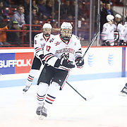 Torin Snyderman #17 of the Northeastern Huskies on the ice during the game at Matthews Arena on February 22, 2014 in Boston, Massachusetts . (Photo by Elan Kawesch)