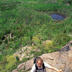 Acadia N.P., ME. Hiking on the Beehive Trail.  The Atlantic Ocean is in the distance.