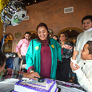 FAIRFAX, VA -DEC21: Emerita Ayala, 23, cuts her graduation cake during a party with friends and family, including her son Dominic, 8, (right), at Guapos restaurant, celebrating her graduation from George Mason University, December 21, 2016, in Fairfax, Virginia. Emerita started as a teenage mom at 18, with her 3-year-old son at community college. She got help through a nonprofit called Generation Hope that provides scholarships and mentoring to teenage moms. (Photo by Evelyn Hockstein/For The Washington Post)