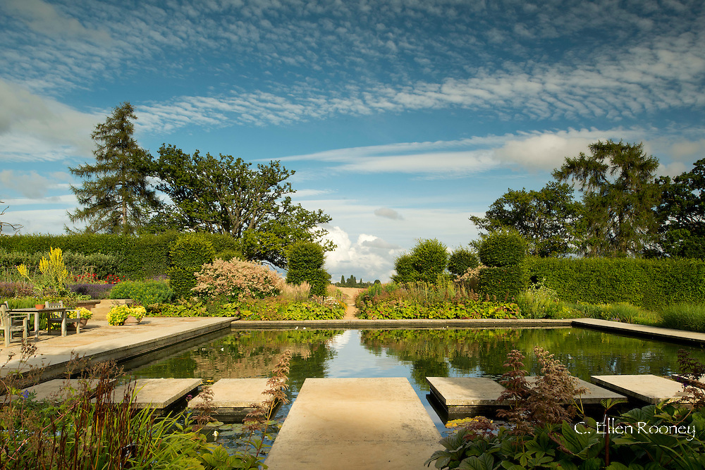 Cement steps through a water feature in the walled garden, Broughton Grange, Banbury, Oxfordshire, UK