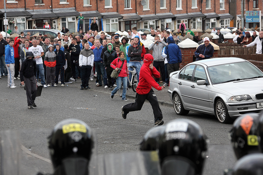 Following the clash between the Catholics and the Protestants at the intersection of the Crumlin Road, and Ardoyne - rioting starts at Brompton Park, Belfast 12/07/2012
