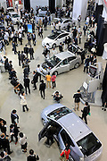 Viisitors look at Toyota Motor Corp.'s third generation Prius hybrid cars during an official unveiling of the vehicle at the automaker's showroom  was in Tokyo, Japan on 18 May 2009.