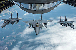 F-15E Strike Eagles with the 4th Fighter Wing at Seymour Johnson Air Force Base, N.C., form up behind a KC-135 Stratotanker with the 121st Air Refueling Wing, Ohio Air National Guard, June 15, 2018. The Stratotanker had just finished refueling the Strike Eagles. (U.S. Air National Guard photo by Airman 1st Class Tiffany A. Emery)