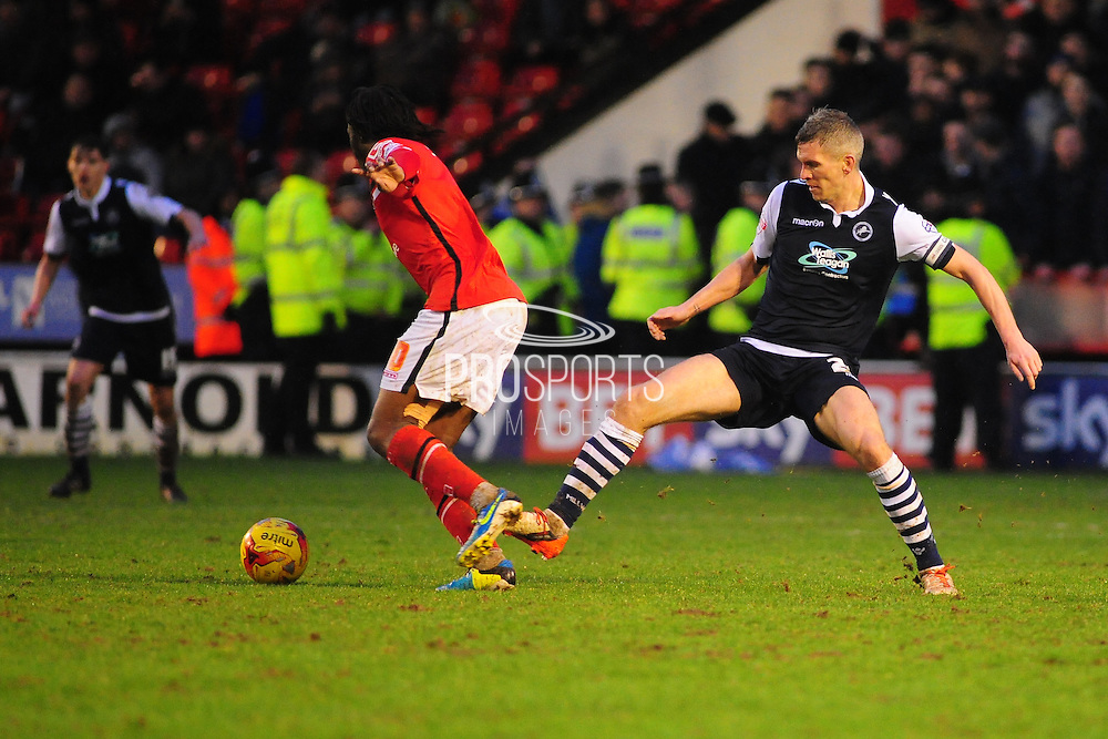 Byron Webster of Millwall FC tackles Romaine Sawyers of Walsall FC during the Sky Bet League 1 match between Walsall and Millwall at the Banks's Stadium, Walsall, England on 6 February 2016. Photo by Mike Sheridan.