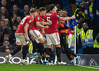Football - 2019 / 2020 EFL Carabao (League) Cup - Fourth Round: Chelsea vs. Manchester United<br /> <br /> Manchester United players celebrate after taking the lead following Marcus Rashford (Manchester United) free kick at Stamford Bridge <br /> <br /> COLORSPORT/DANIEL BEARHAM