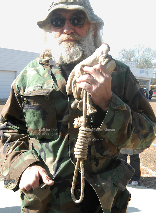David Dupre a white supremists holds a noose he made, outside the LaSalle County Courthouse during Martin Luther King Day protest.A group of protesters march to Jena High School on the Martin Luther King Jr. holiday in Jena, La., Monday, Jan. 21, 2008. The protest was organized by the self-described 'pro-majority' Nationalist Movement of Learned, Mississippi, lead by Richard Barrett, and was being held in opposition to the six black teenagers who were arrested in the beating of a white classmate in December 2006, and the King holiday. The protest drew about 50 participants and 100 counter-demonstrators to Jena.(Photo/© Suzi Altman)