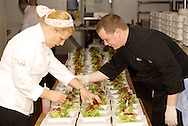 Chef Anne Kearney (left) and Billy Grise get the second course ready to serve during The Masterpiece Ball, an evening with the Great Chefs, the 2010 2009 Opera Guild Gala at the Dayton Masonic Center, Saturday, March 13, 2010.
