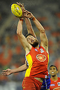 GOLD COAST, AUSTRALIA - JUNE 08:  Charlie Dixon of the Suns competes for the mark during the round 11 AFL match between the Gold Coast Suns and the North Melbourne Kangaroos at Metricon Stadium on June 8, 2013 on the Gold Coast, Australia.  (Photo by Matt Roberts/Getty Images)
