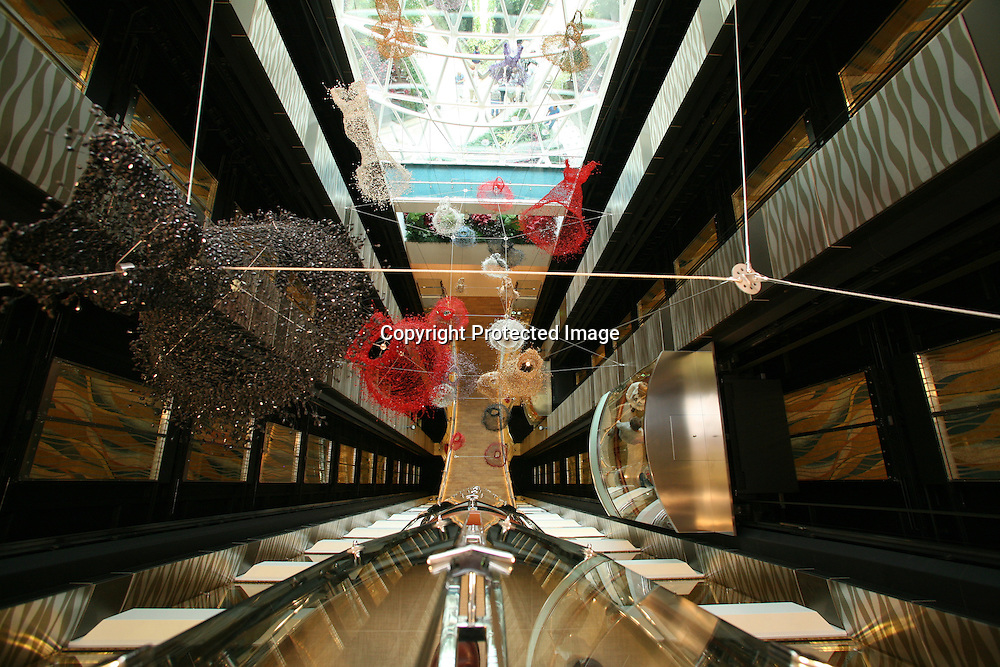 Launch of Royal Caribbean International's newest ship Allure of the Seas..View of lift atrium with suspended dresses.