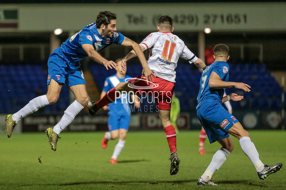 Adam Jackson (on loan from Middlesbrough) (Hartlepool United) watches on as Tom Pett (Stevenage) gets a header in on goal during the Sky Bet League 2 match between Hartlepool United and Stevenage at Victoria Park, Hartlepool, England on 9 February 2016. Photo by Mark P Doherty.
