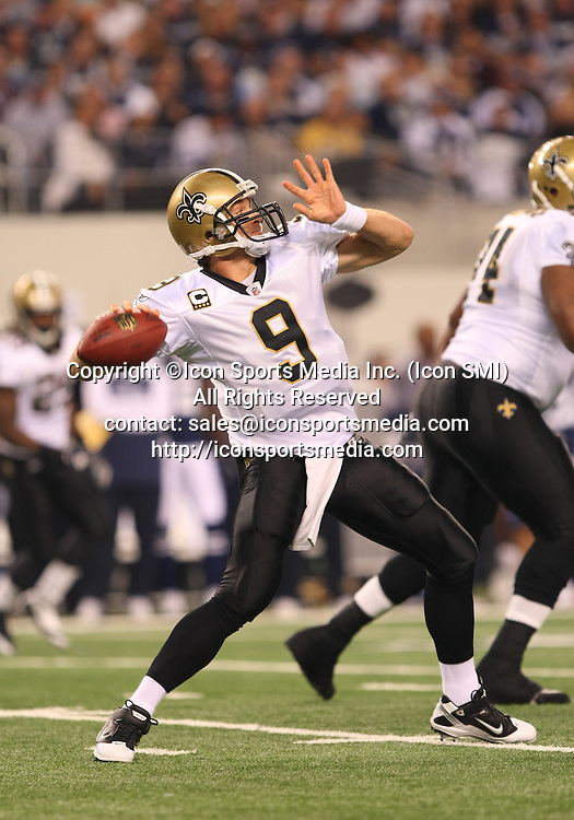 25 November 2010: New Orleans Saints quarterback Drew Brees #9 throws the football down the field during the game between the Dallas Cowboys and the New Orleans Saints at Cowboys Stadium in Arlington, Texas. The Saints beat the Cowboys 30-27.