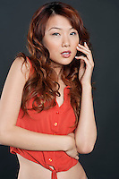Portrait of sensual Chinese woman over colored background