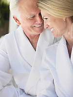 Smiling couple in bathrobes