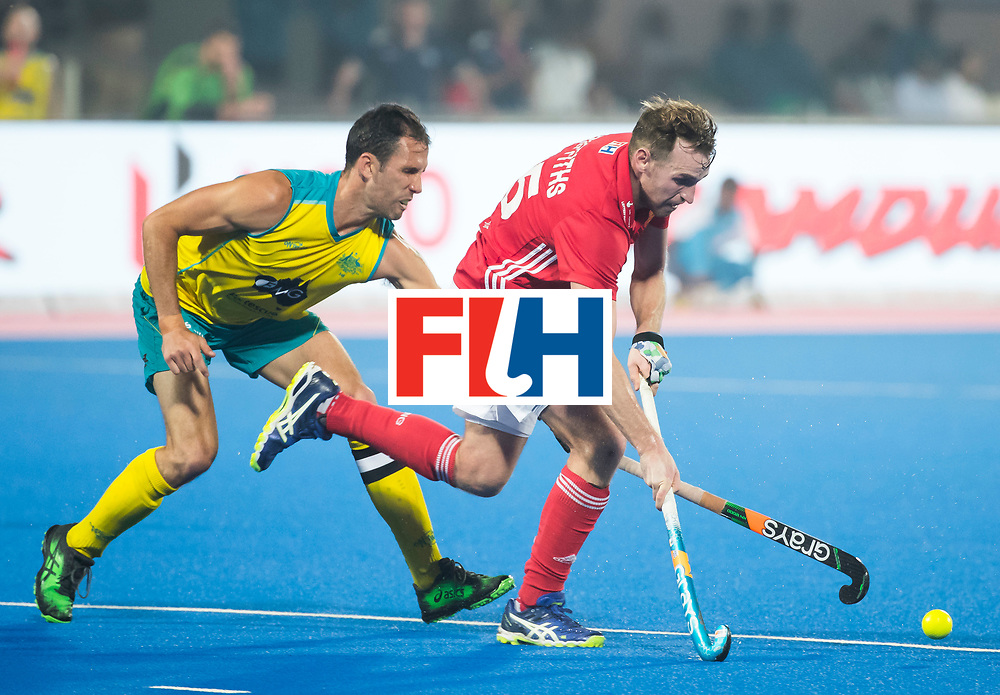 BHUBANESWAR - The Odisha Men's Hockey World League Final . Match ID 09 .  Australia v England  .Chris Griffiths (Eng) with Mark Knowles (Aus)    WORLDSPORTPICS COPYRIGHT  KOEN SUYK
