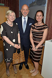 Left to right, EILEEN COOPER Keeper of the RA, METIN GUVENER and DENIZ HUYSAL at a cocktail reception to celebrate the launch of the Bicester Village the British Designer's Collective 2014 held at the The Keeper's House, Royal Academy of Art, Piccadilly, London on 20th May 2014.