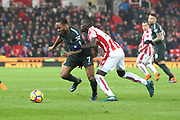 Raheem Sterling and Badou Ndiaya during the Premier League match between Stoke City and Manchester City at the Bet365 Stadium, Stoke-on-Trent, England on 12 March 2018. Picture by Graham Holt.