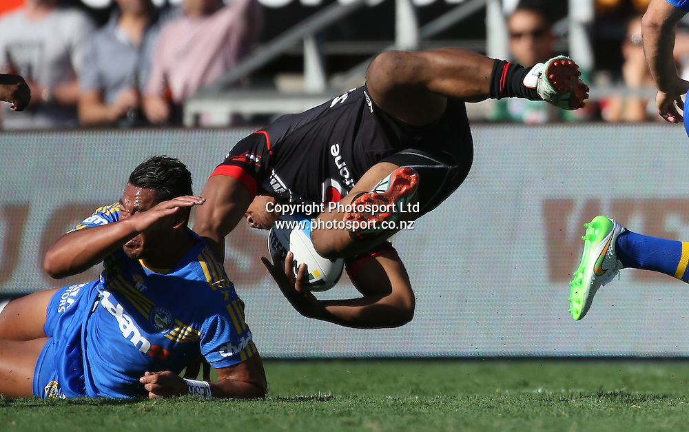 NZ Warriors player Solomone Kata is flipped in a tackle during the NRL Rugby League match between the NZ Warriors and the Parramatta Eels played at Mt Smart Stadium in South Auckland on the 21st March 2015. <br /> <br /> Copyright Photo; Peter Meecham/ www.photosport.co.nz