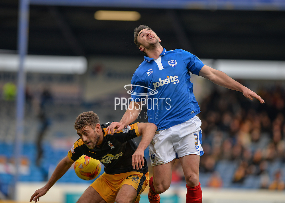 Portsmouth defender Enda Stevens beats Cambridge United Forward Ben Williamson join the air during the Sky Bet League 2 match between Portsmouth and Cambridge United at Fratton Park, Portsmouth, England on 27 February 2016. Photo by Adam Rivers.