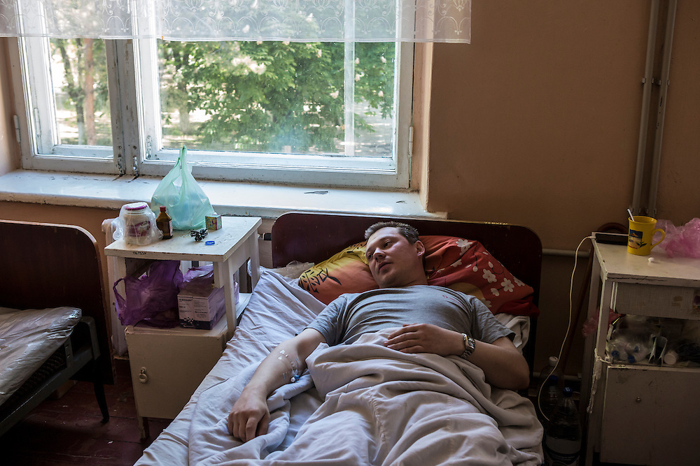 MARIUPOL, UKRAINE - MAY 10: Vladimir Presnyakov lies in a hospital bed after being shot in the leg during deadly clashes a day earlier on May 10, 2014 in Mariupol, Ukraine. A referendum on greater autonomy is planned for the region tomorrow. (Photo by Brendan Hoffman/Getty Images) *** Local Caption ***