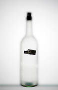 glass bottle with cork and small label