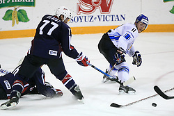 Tom Gilbert (77) and Saku Koivu at play-off round quarterfinals ice-hockey game USA  vs Finland at IIHF WC 2008 in Halifax,  on May 14, 2008 in Metro Center, Halifax, Nova Scotia,Canada. Win of Finland 3 : 2. (Photo by Vid Ponikvar / Sportal Images)