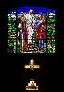 The stained glass and cross that adorn the alter of The Pitman Presbyterian Church.