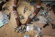"""Maasai women make key rings for the Italian fashion brand MAX&Co. at the Marula Studios, Nairob, Kenya, on Monday, Jan. 12, 2009. The Maasai tribe are renowned for their expert bead work and as such have been hired to help create part of MAX&Co.'s """"ethical fashion"""" range in Africa. The limited edition collection consists of a range of handmade accessories such as shoulder-bags, bracelets, key-rings, belts and scarfs."""