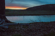 Peyote ceremony, Native American Church, dawns light illuminates Little Bighorn River after ceremony, Crow Indian Reservation, Montana