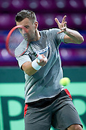 Michal Przysiezny of Poland while training session three days before the BNP Paribas Davis Cup 2014 between Poland and Croatia at Torwar Hall in Warsaw on April 1, 2014.<br /> <br /> Poland, Warsaw, April 1, 2014<br /> <br /> Picture also available in RAW (NEF) or TIFF format on special request.<br /> <br /> For editorial use only. Any commercial or promotional use requires permission.<br /> <br /> Mandatory credit:<br /> Photo by © Adam Nurkiewicz / Mediasport