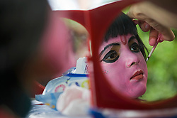 © Licensed to London News Pictures. 21/08/2011. Aldenham, UK. A young girl has her face painted at Bhaktivedanta Manor Temple near Watford today (21/08/2011) to celebrate  the festival of Janmashtami, a celebration of the birth anniversary of Lord Krishna. Janmashtami at Bhaktivedanta Manor is the largest Krishna gathering outside of India with over 60,000 people attending over two days. Bhaktivedanta Manor was donated to the Hare Krishna movement in the early 1970's by former Beatle George Harrison. Photo credit: Ben Cawthra/LNP