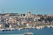 Skyline cityscape and the Blue Mosque and passenger ferry boat  on Bosphorus River in Istanbul, Republic of Turkey