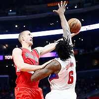 12 December 2016: Portland Trail Blazers center Mason Plumlee (24) goes for the layup against LA Clippers center DeAndre Jordan (6) during the LA Clippers 121-120 victory over the Portland Trail Blazers, at the Staples Center, Los Angeles, California, USA.