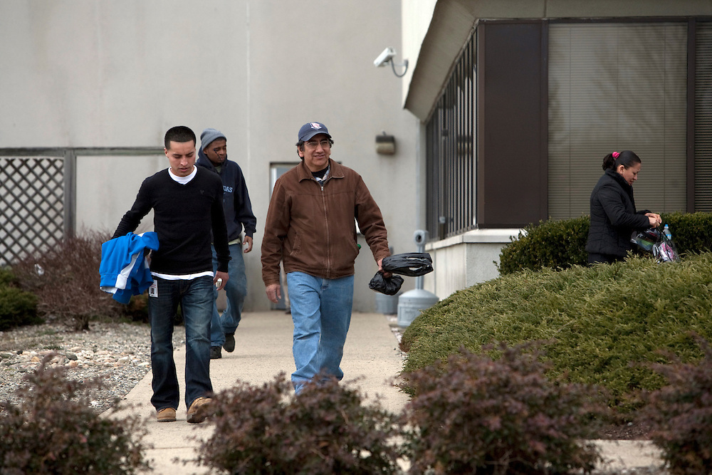 Temp workers leave the warehouse and head back home in vans provided by temping agencies in New Brunswick, NJ on March 22, 2013..Across America, temp work has become a mainstay of the blue-collar economy, leading to the proliferation of ?temp towns? ? places where it's difficult to find work except through a temp agency and where workers suffer wage theft, no benefits and high injury rates, all for jobs that may end tomorrow for any reason.