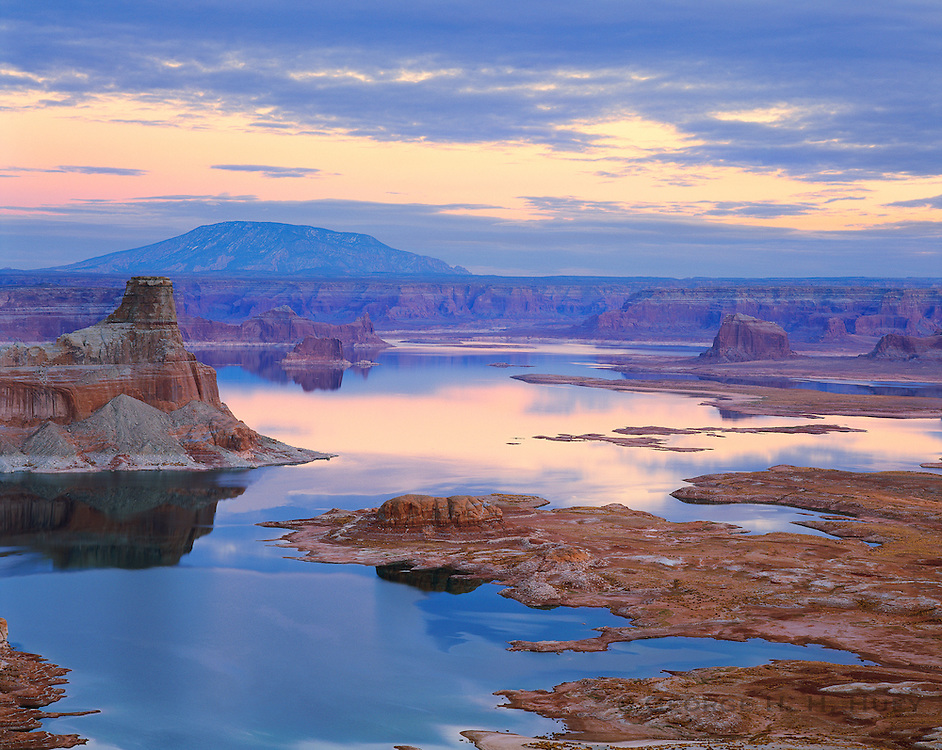 0303-1006LVT ~ Copyright: George H. H. Huey ~ Lake Powell at dusk, with Gunsight Butte, and Navajo Mountain [sacred to Navajo Indians] in distance. Padre Bay in foreground. National Park Service area. Glen Canyon National Recreation Area, Utah/Arizona.