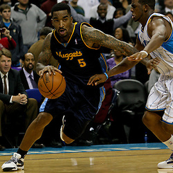 Dec 18, 2009; New Orleans, LA, USA;  Denver Nuggets guard J.R. Smith (5) drives in past New Orleans Hornets guard Chris Paul (3) during the second half at the New Orleans Arena. The Hornets defeated the Nuggets 98-92. Mandatory Credit: Derick E. Hingle-US PRESSWIRE