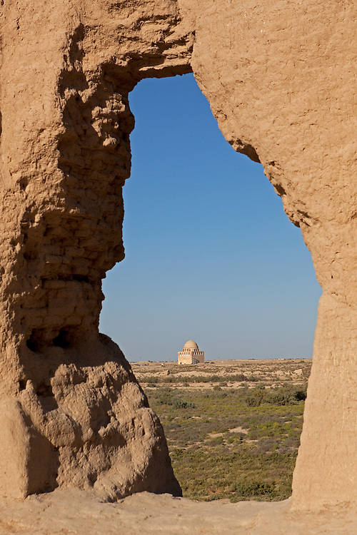 A view through the ruins of Sultan Sanjar's tomb in the remains of Merv, Turkmenistan. Merv is the site of several ancient cities founded over the millennia, now a UNESCO World Heritage Site archaeology park in Turkmenistan.  It is the country's biggest tourist destination, as Merv was a major silk road city in its day, and according to some British archaeologists, it was the world's biggest city in the mid 12th century (and was at least the 3rd largest).  It was one of the Islamic world's greatest centres of learning, with 12 libraries and countless books.  It also appears to have been the furthest west point that Buddhism ever reached, with the discovery of a Buddha head statue in a complex within one of the older city walls -- quite possibly a meditation complex or monastery. The city may have been home to up to 1 million people when it was sacked by the Mongols.  The city surrendered, but the invaders killed all its inhabitants, and despite the attempt to revive it during Timur's empire, the city never flourished again.  Now a modern soviet town, Mary, is nearby.